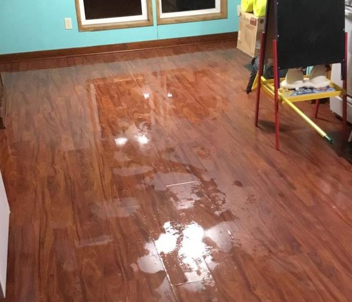 Water fills customers living room after a pipe burst